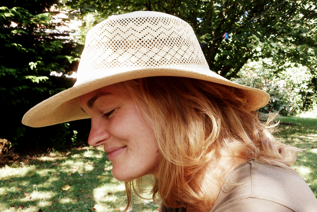 Veronica wearing a hat in the garden