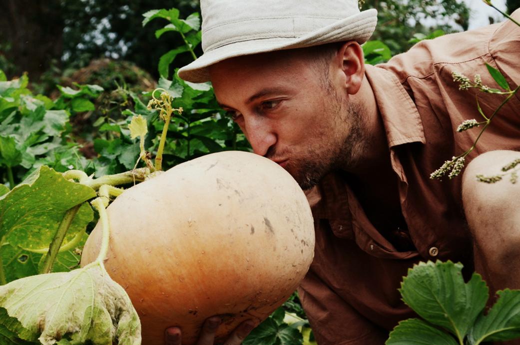 Jean kissing a pumpkin in the garden