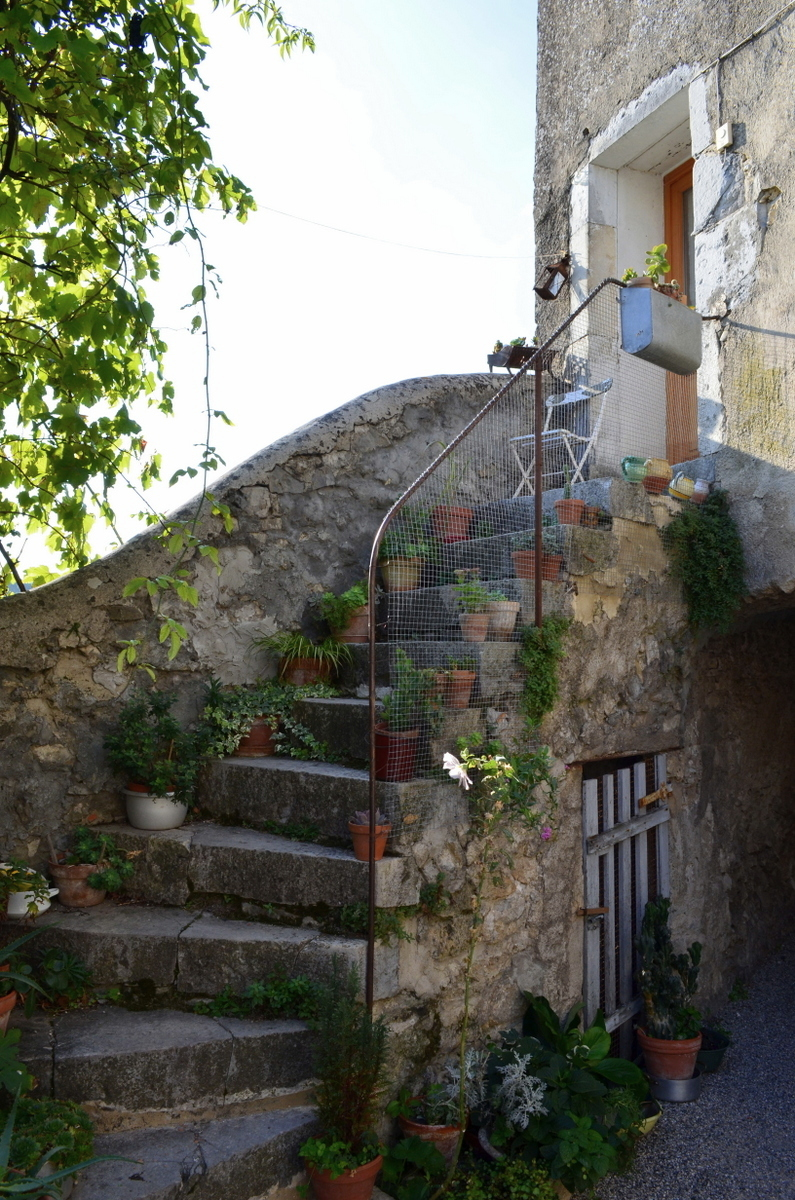 Stairs with loads of plants adds to the village charm